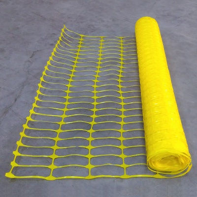 Yellow plastic mesh barrier safety fencing + steel fencing pins